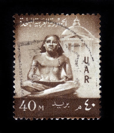 scribe: EGYPT - CIRCA 1959: A stamp printed by Egypt, shows sculpture of the seated scribe, circa 1959