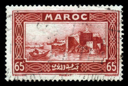 MOROCCO - CIRCA 1934: A stamp printed in Morocco shows capital city of Rabat on the Atlantic coast, red, circa 1934 Stock Photo - 18646160
