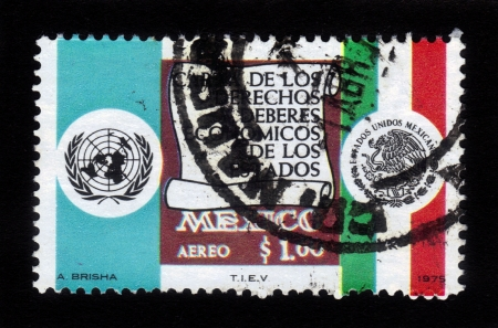 MEXICO - CIRCA 1975  a stamp printed in the Mexico shows national state flag and  coat of arms of Mexico, and emblem of the United Nations, circa 1975 Stock Photo - 18646139