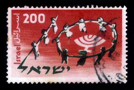 jewish group: Israel - circa 1958  A stamp printed in Israel, shows a group of young people dancing, forming the figure 10 , devoted to 10th anniversary of jewish youth conference, circa 1958
