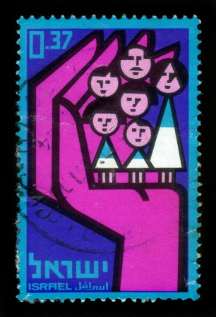 Israel - circa 1964  A stamp printed in Israel, shows large family stands on hand , devoted to 10th anniversary of national insurance institute of Israel, circa 1964 Stock Photo - 18646168