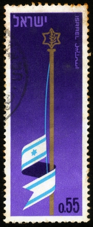 ISRAEL - CIRCA 1969  A stamp printed in the Israel, shows symbolic image - Israeli flag at half-mast, devoted to memorial Day for the fallen of israel s defence army, circa 1969 Stock Photo - 18864506