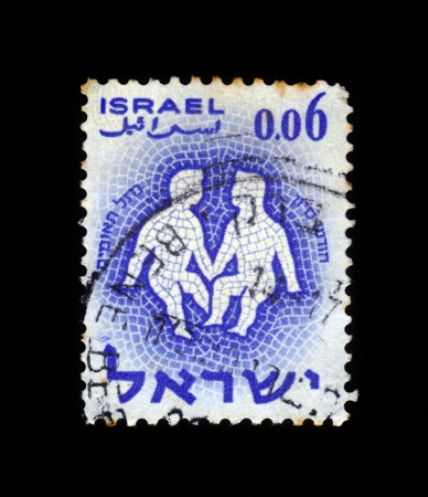 ISRAEL - CIRCA 1961  A stamp printed in the Israel, shows sign of the zodiac Twins - Gemini, - month of Sivan, circa 1961 Stock Photo - 18876443