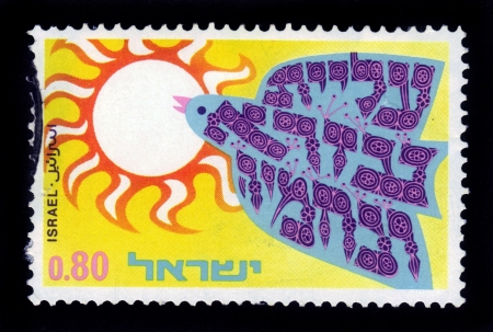 ISRAEL - CIRCA 1970  A stamp printed in Israel shows bird flying to the sun, dedicated to 20th anniversary of the exodus of Iraqi Jews to Israel, operation Ezra and Nehemia, circa 1970 Stock Photo - 19010089