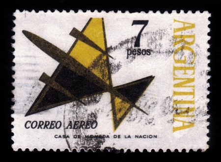 ARGENTINA - CIRCA 1963  A stamp printed in Argentina shows flight of symbolic airplane , yellow, circa 1963  Stock Photo - 19010084