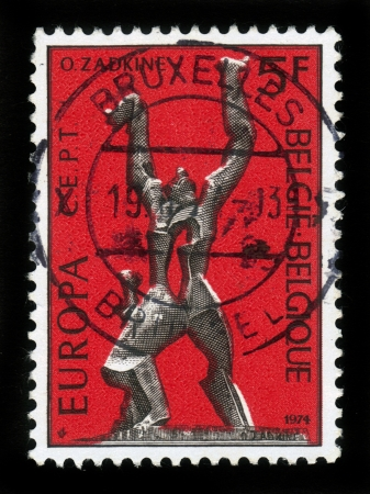 BELGIUM - CIRCA 1974  A stamp printed by Belgium, shows sculpture, destroyed city by Ossip Zadkine, Belgium, circa 1974 Stock Photo - 19010090