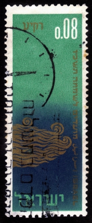 succot: ISRAEL - CIRCA 1965  A stamp printed in Israel shows symbolic representation of the heavens, the Creation, as described in Genesis, chapter 1,circa 1965 Editorial