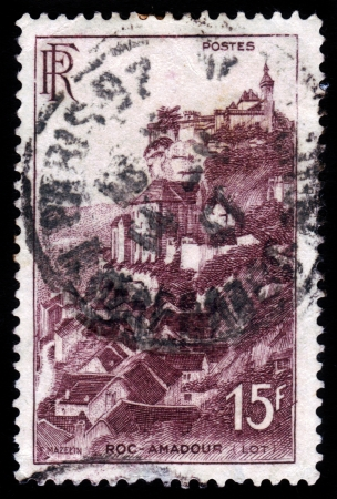 France - CIRCA 1946: A stamp printed in France shows medieval village and monastery of Rocamadour, Lot, circa 1946. Stock Photo - 19257247