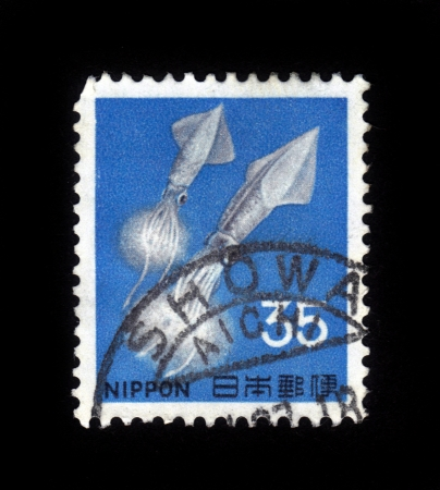 JAPAN - CIRCA 1969: A post stamp printed in Japan shows two squids, circa 1969 Stock Photo - 19391235