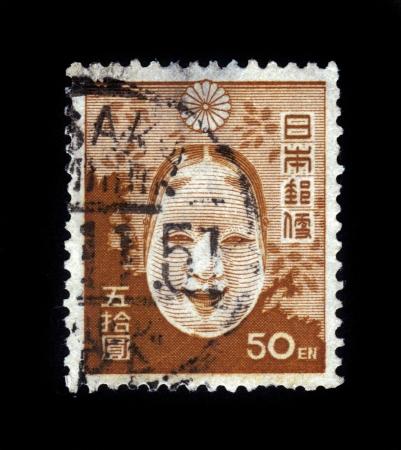 JAPAN - CIRCA 1947: A post stamp printed in Japan shows japanese otafuku mask, circa 1947 Stock Photo - 19391236