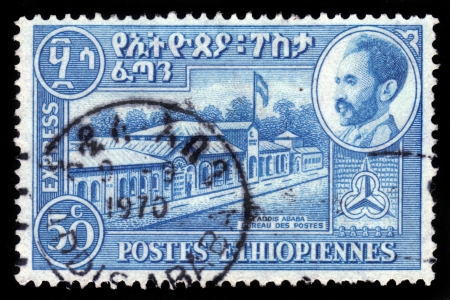 ETHIOPIA - CIRCA 1947 : A stamp printed in Ethiopia shows portrait of emperor Haile Selassie and post office building in Addis Ababa , with the inscription in amharic , series, circa 1947 Stock Photo - 19391243