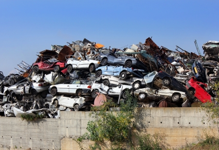 scrap car: ecological concept by dump of wrecked cars Stock Photo
