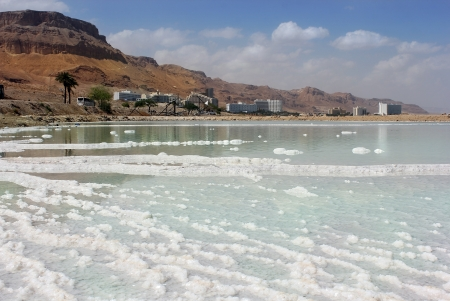 salt deposits and the views of the resort area on the Dead Sea, Israel