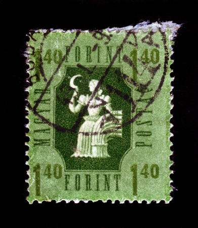 HUNGARY - CIRCA 1946  A stamp printed in Hungary shows woman with a sickle as a symbol of the Agriculture, from the series  Industry and Agriculture , circa 1946  Stock Photo - 19598766