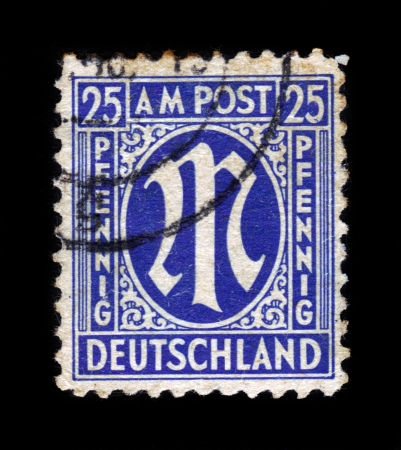 definitive: GERMANY - CIRCA 1945: A stamp printed in American-British occupation zone shows definitive stamp series M in denomination of 25 pfennig, circa 1945