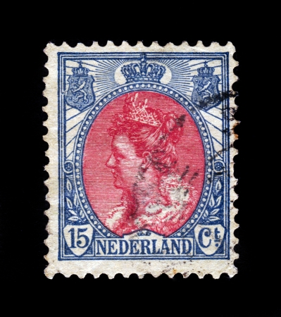 wilhelmina: NETHERLANDS - CIRCA 1898: A stamp printed in Netherlands shows portrait of Queen Wilhelmina - Queen regnant of Netherlands, crown, coat of arms, series Queen Wilhelmina, circa 1898