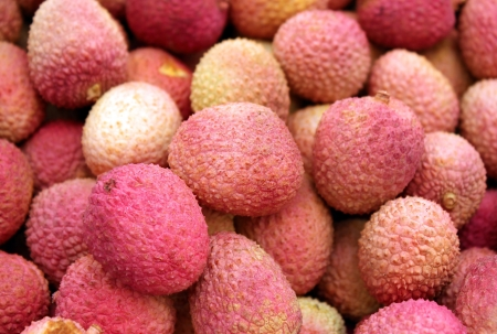 pink freshly cut fruits lychee as an agricultural background