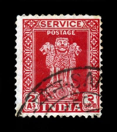INDIA - CIRCA 1958: A stamp printed in India shows four Indian lions capital of ashoka pillar, circa 1958 Stock Photo - 20294684