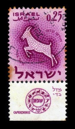 capricornus: ISRAEL - CIRCA 1961  A stamp printed in the Israel, shows sign of the zodiac capricornus - goat, - month of tevet, circa 1961
