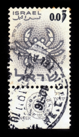ISRAEL - CIRCA 1962  A stamp printed in the Israel, shows sign of the zodiac crab - cancer, - month of tammuz, circa 1962