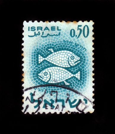 ISRAEL - CIRCA 1961  A stamp printed in the Israel, shows sign of the zodiac Fishes - Pisces, - month of Adar, circa 1961