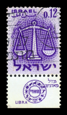 ISRAEL - CIRCA 1961  A stamp printed in the Israel, shows sign of the zodiac libra - scales, - month of tishri, circa 1961 Stock Photo - 20411175