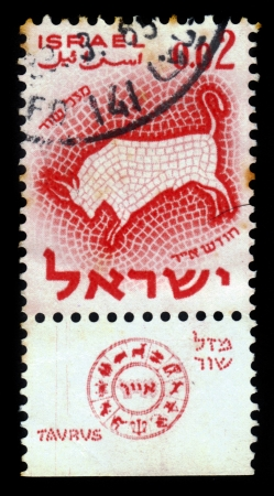 ISRAEL - CIRCA 1961  A stamp printed in the Israel, shows sign of the zodiac taurus - bull, - month of Iyyar, circa 1961 photo