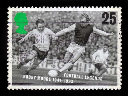 bobby: UNITED KINGDOM - CIRCA 1996  A stamp printed in Great Britain shows Bobby Moore, football legends, circa 1996 Editorial