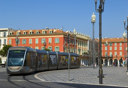 tramcar: NICE, FRANCE - August 18  Modern tram in the center of Nice, France, on August 18, 2009 Central Square - Place Massena, the tram system in Nice opened in 2007 Editorial