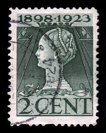 wilhelmina: HOLLAND - CIRCA 1923  A stamp printed in the Holland shows image of Queen Wilhelmina, circa 1923 Editorial
