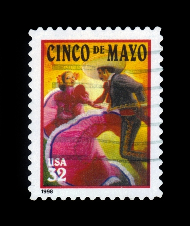 UNITED STATES OF AMERICA - CIRCA 1998  A stamp printed in USA shows an image of mexican flamenco dancers celebrating Cinco De Mayo, Mexico independence, circa 1998