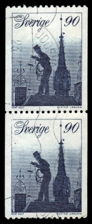 SWEDEN - CIRCA 1976  A stamp printed in Sweden, shows chimney sweep on the roofs of Stockholm, circa 1976 photo
