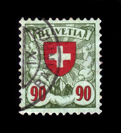 SWITZERLAND - CIRCA 1924  A stamp printed by Switzerland, shows red cross, coat of arms of Switzerland, circa 1924  Stock Photo - 21558347