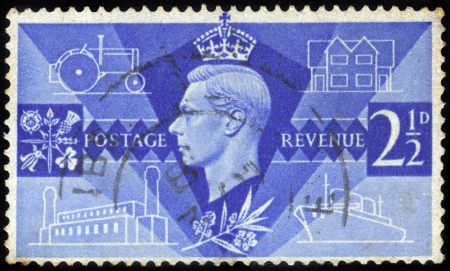 commemoration: UNITED KINGDOM - CIRCA 1946  A stamp printed in United Kingdom shows King George VI portrait and symbols of peace and reconstruction, series   Victory Commemoration   , circa 1946  Editorial