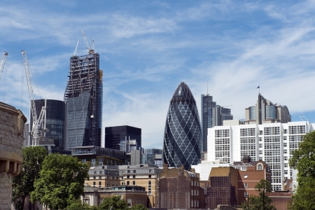 Modern buildings in London and building, called Swiss Re or informally the Gherkin, England Editorial