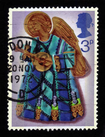 lute: GREAT BRITAIN - CIRCA 1972  a stamp printed in the Great Britain shows angel with lute, without inscriptions, from the series   Christmas  , Christmas Card, circa 1972