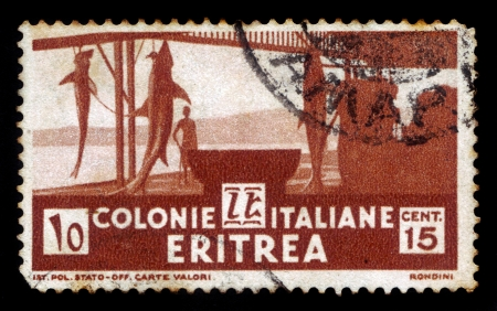 Eritrea - CIRCA 1934  a stamp printed by Italy  for Italian colony Eritrea  shows shark fishery, circa 1934