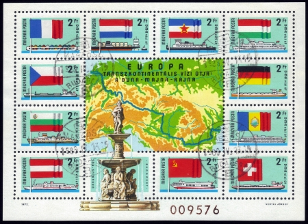 Hungary- CIRCA 1977  A stamp printed in Hungary, shows riverboats and the national flags of the countries through which passes the European transcontinental waterway   Danube - Main - Rhine, circa 1977