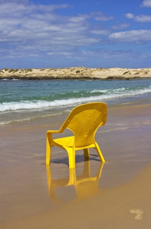 lonely yellow chair on the beach Mediterranean sea in good weather