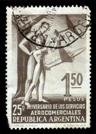 ARGENTINA - CIRCA 1955  a stamp printed in the Argentina shows a man and a boy on a background model airplanes, circa 1955