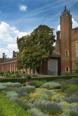 Hampton Court Palace, a magnificent example of landscape and gardening design, London, UK photo