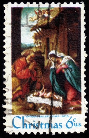 UNITED STATES OF AMERICA - CIRCA 1970  A Christmas stamp printed in the United States of America shows the Nativity by Lorenzo Lotto, circa 1970