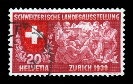 national poet: SWITZERLAND - 1939  A stamp printed in Switzerland shows coat of arms of confederation, family listen to the Senn Alm a poet, symbolizing spiritual life, to commemorate Switzerland national exhibition, Zurich 1939, circa 1939 Editorial
