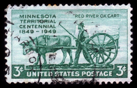 establishment states: UNITED STATES OF AMERICA - CIRCA 1949  a stamp printed in the USA shows pioneer and red river oxcart, centenary of the establishment of Minnesota Territory, circa 1949