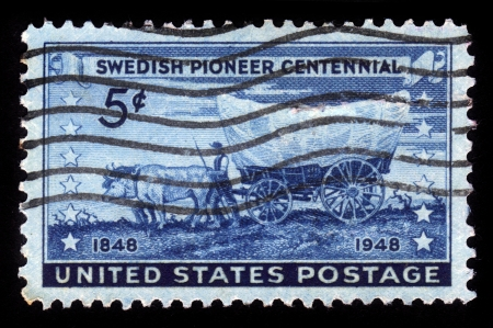 covered wagon: UNITED STATES - CIRCA 1948  stamp printed by United States, shows swedish pioneer with covered wagon moving westward, honoring swedish pioneer centennial, circa 1948 Stock Photo