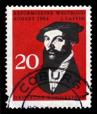 theologian: GERMANY -CIRCA 1964  A stamp printed in Germany shows John Calvin, influential French theologian and pastor during the Protestant Reformation, circa 1964 Stock Photo