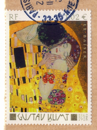 FRANCE - CIRCA 2002  A stamp printed in France shows The Kiss by Gustav Klimt, circa 2002 photo