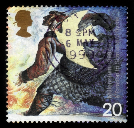 UNITED KINGDOM - CIRCA 1999  A stamp printed in Great Britain shows dove and norman settler  medieval migration to Scotland  , millennium series, circa 1999 photo