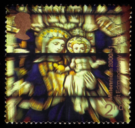 UNITED KINGDOM - CIRCA 2000  A stamp printed in Great Britain shows Madonna and child, stained glass window, st edmundsbury cathedral  suffolk cathedral milennium project , circa 2000 photo