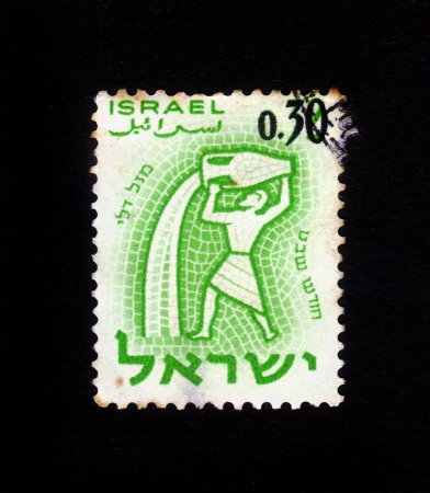 ISRAEL - CIRCA 1961  A stamp printed in the Israel, shows sign of the zodiac aquarius, - month of sabbath, circa 1961